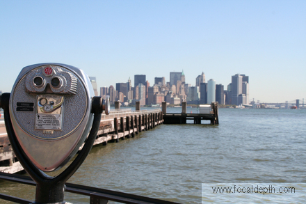 USA - Looking across to Manhattan from telescope stands on Liberty Island