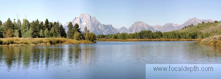 USA - The view at Oxbow Bend Turnout, with Snake River in the foreground and the Grand Teton Range of mountains in the background.