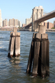 USA - Old mooring posts near Brooklyn Bridge, New York