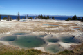 Yellowstone - Various thermal pools at West Thumb Geyser Basin, looking towards Yellowstone Lake